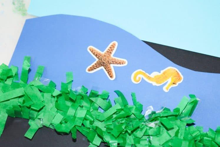 preschooler's ocean zones collage with sea creature stickers