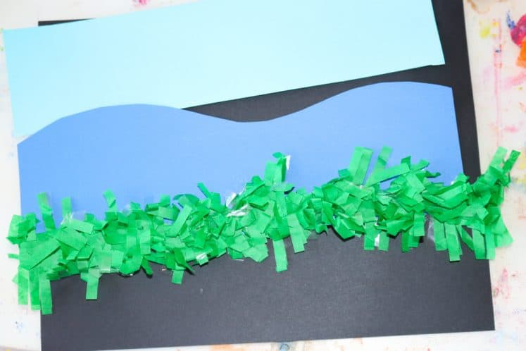 blue cardstock strips and green festoon on background paper