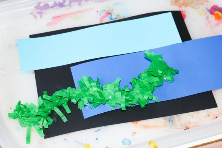 blue cardstock strips and green festoon on tray