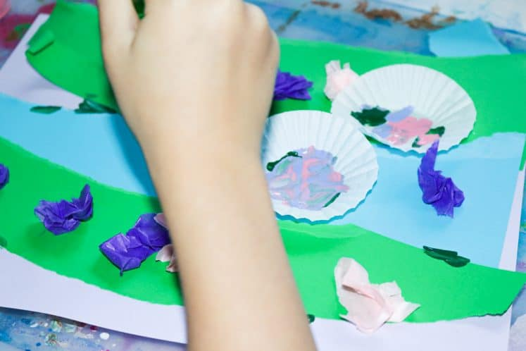 child adding flowers to pond collage
