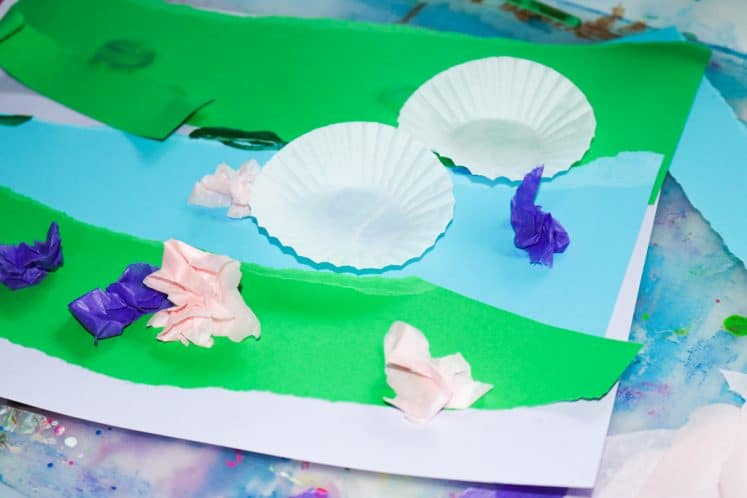 child working on pond collage using cupcake liners and tissue paper