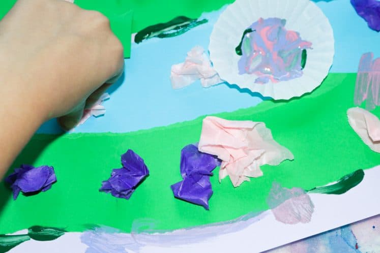 child making water lilies with tissue paper