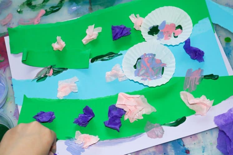 child gluing water lilies to pond collage painting