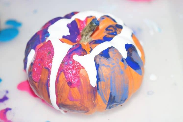 pumpkin process art made from paint and mini pumpkin