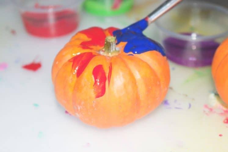 child making pumpkin process art
