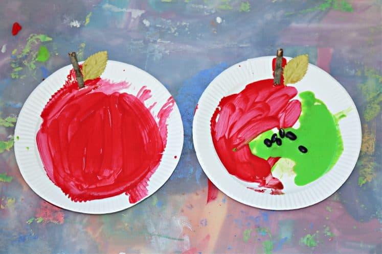 preschooler's apple painting process art on tray