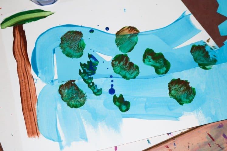 preschooler's river painting on cardstock